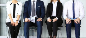 Business People Sitting in Chairs