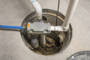 sump pump extracting water from basement